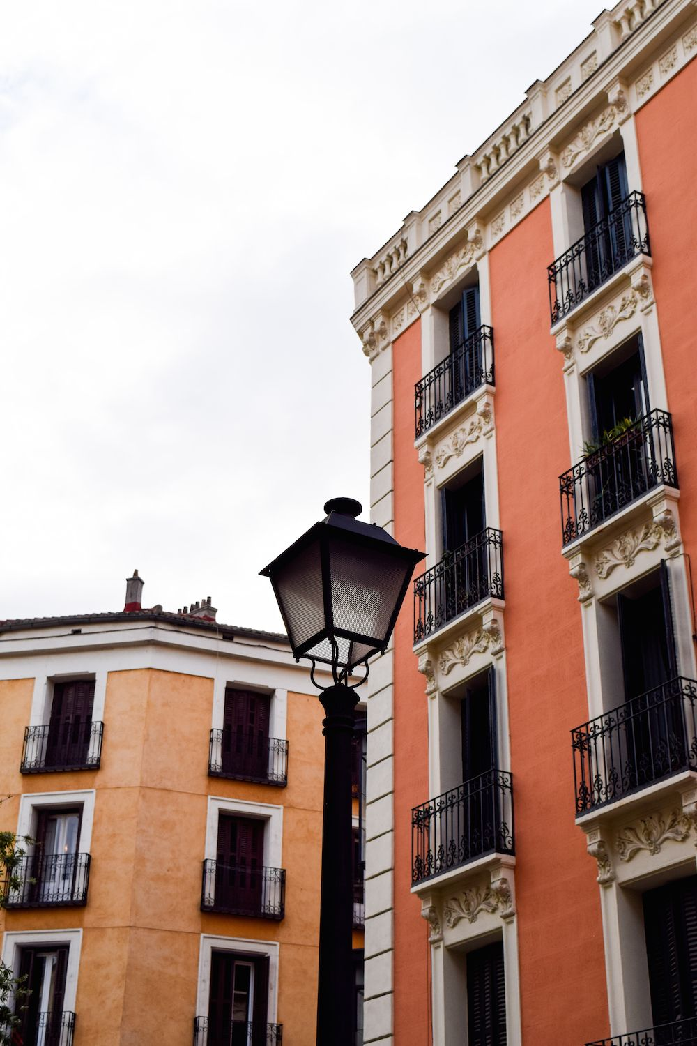 Orange and coral buildings in Malasaña, Madrid