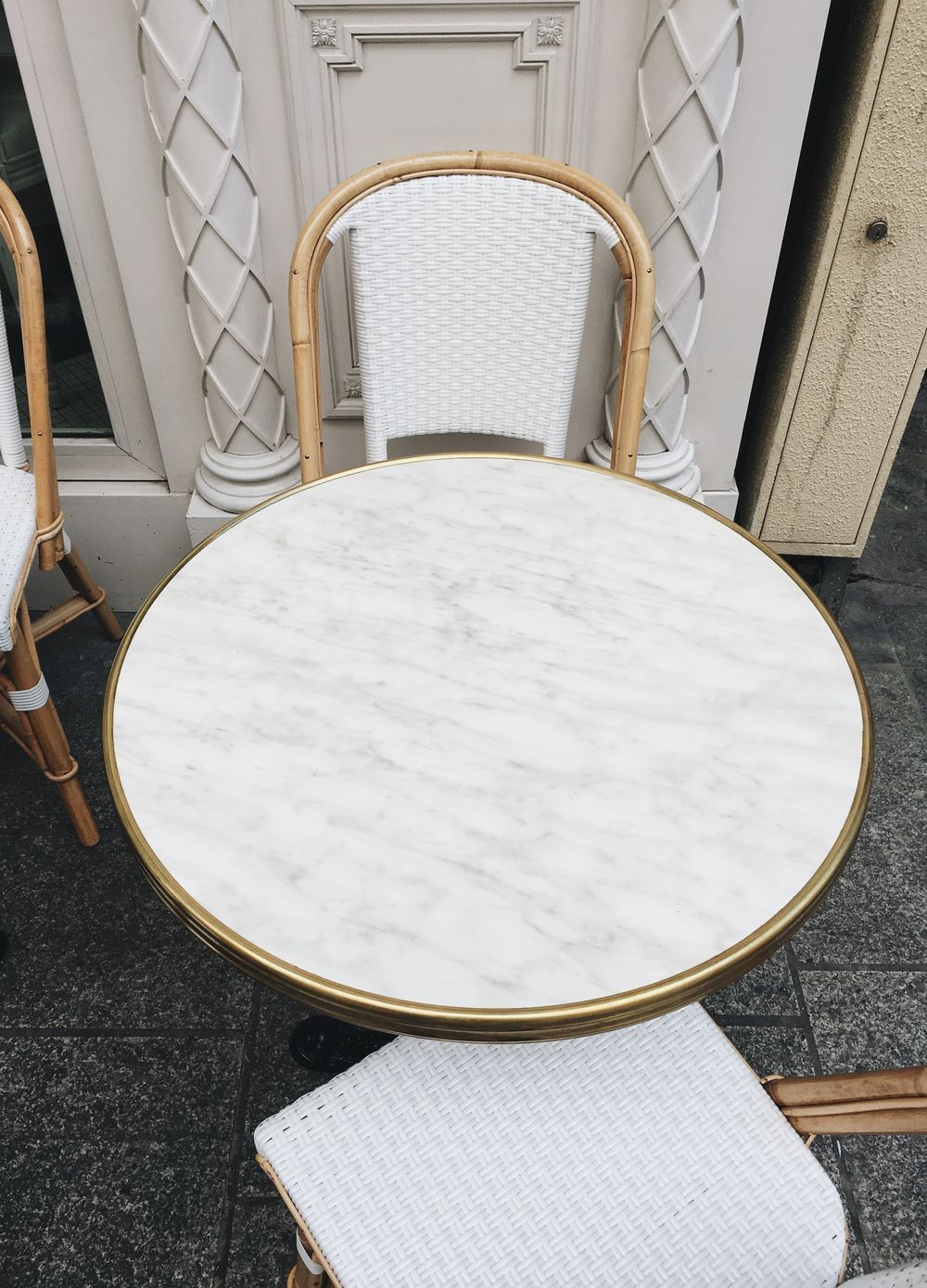 White marble sidewalk cafe table in Paris