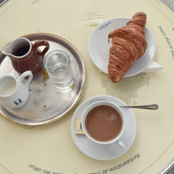 Coffee and croissant at Les Deux Magots, Paris