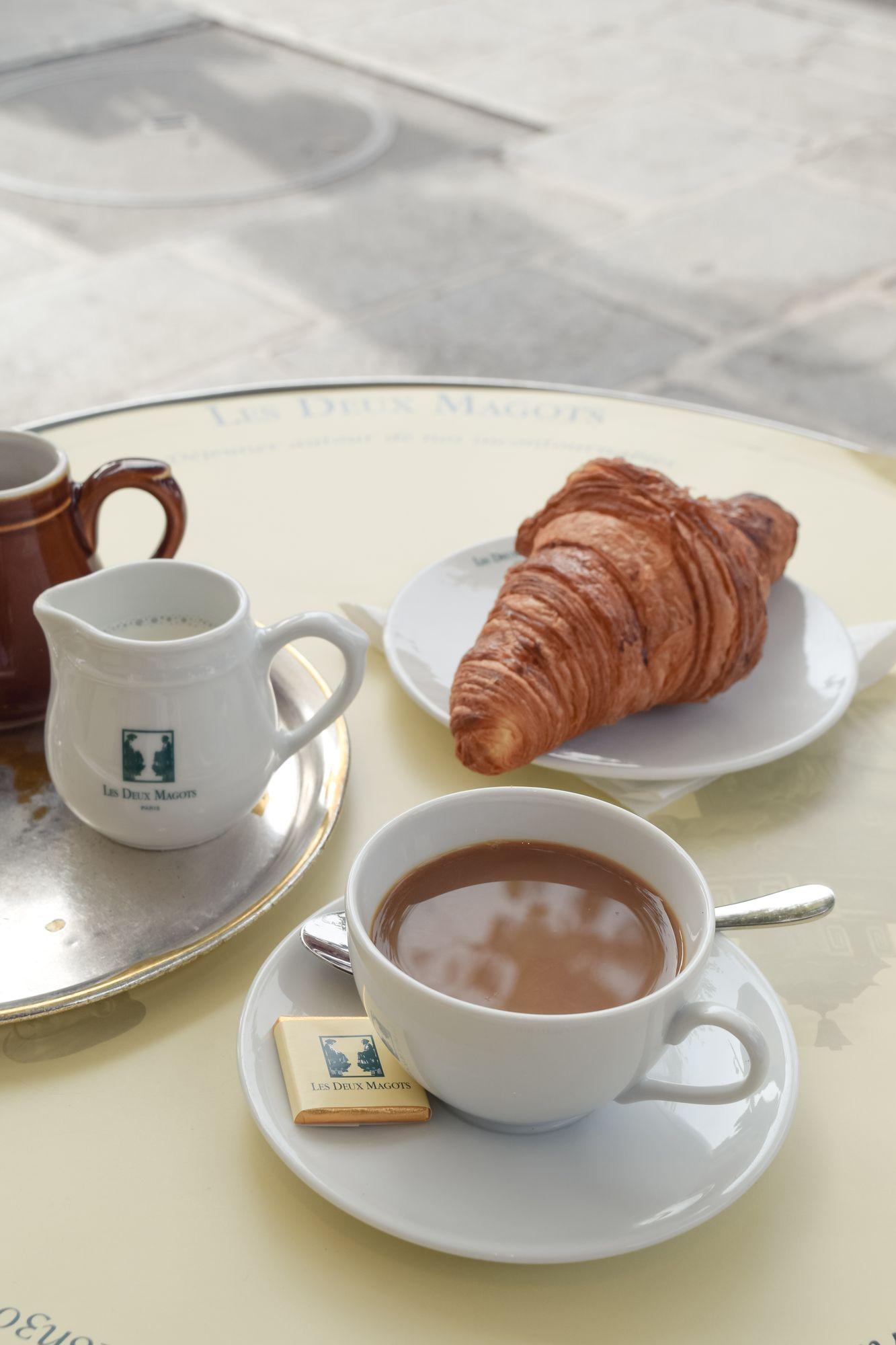 Coffee and croissant at Les Deux Magots, Paris