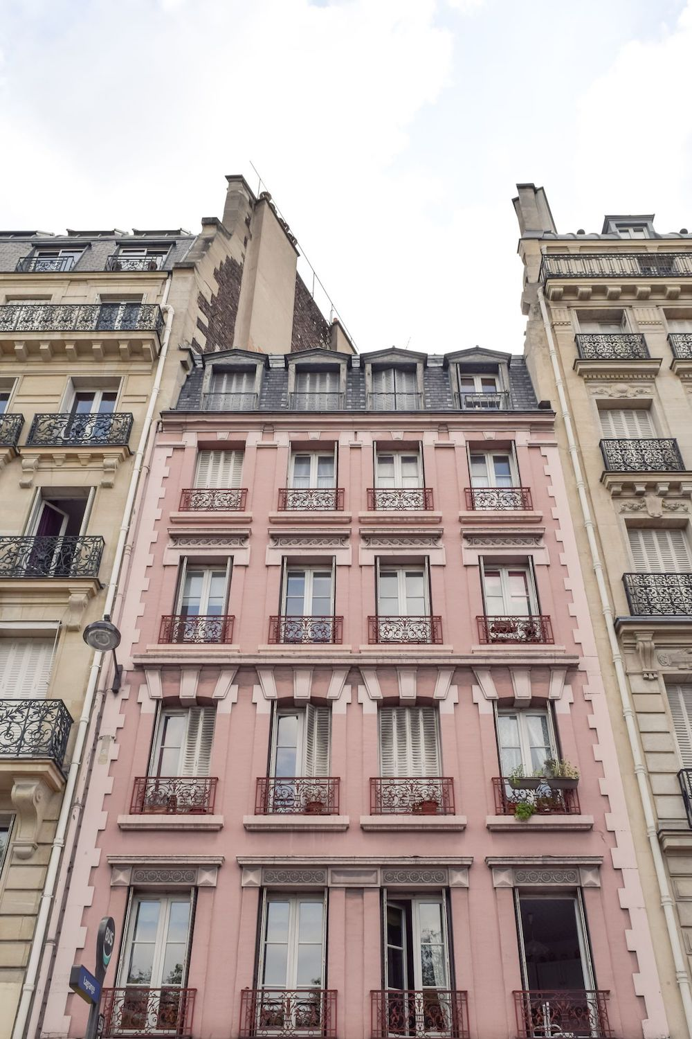 Pink Apartment Building with Pink Balconies in Paris
