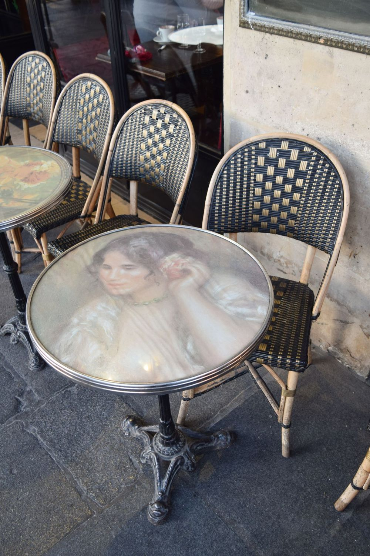 Vintage bistro table on Rue De Rivoli, Paris, France
