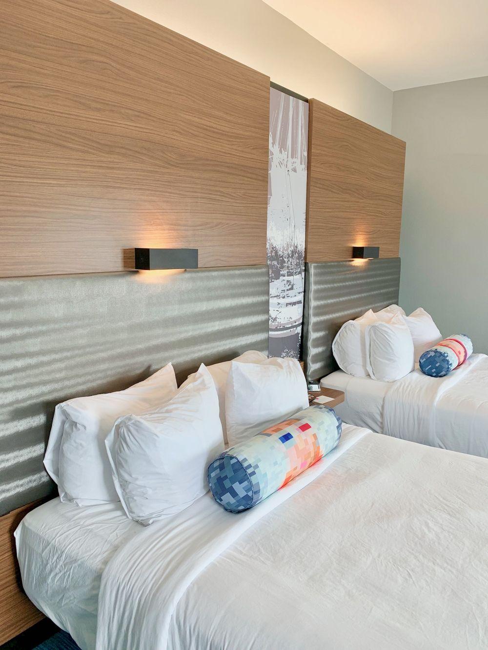 Four pillows on each bed at the Corpus Christi Aloft Hotel