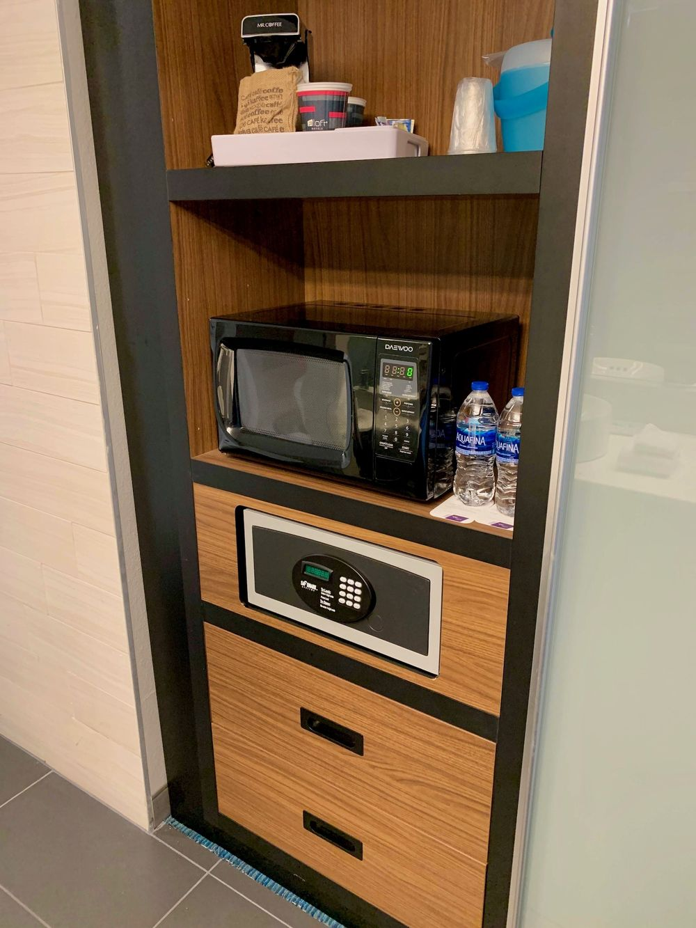 Microwave, Two Free Water Bottles, Safe, and Drawers at the Corpus Christi Aloft Hotel