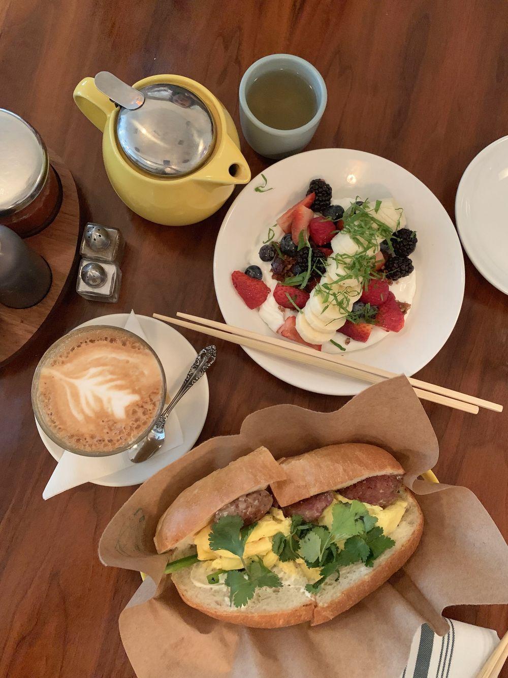 Yogurt and Sausage & Egg Sandwich for breakfast at Elizabeth Street Cafe, Austin