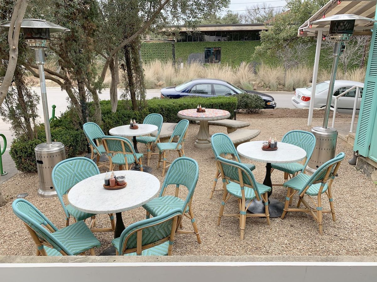 Patio with turquoise french bistro chairs at Elizabeth Street Cafe