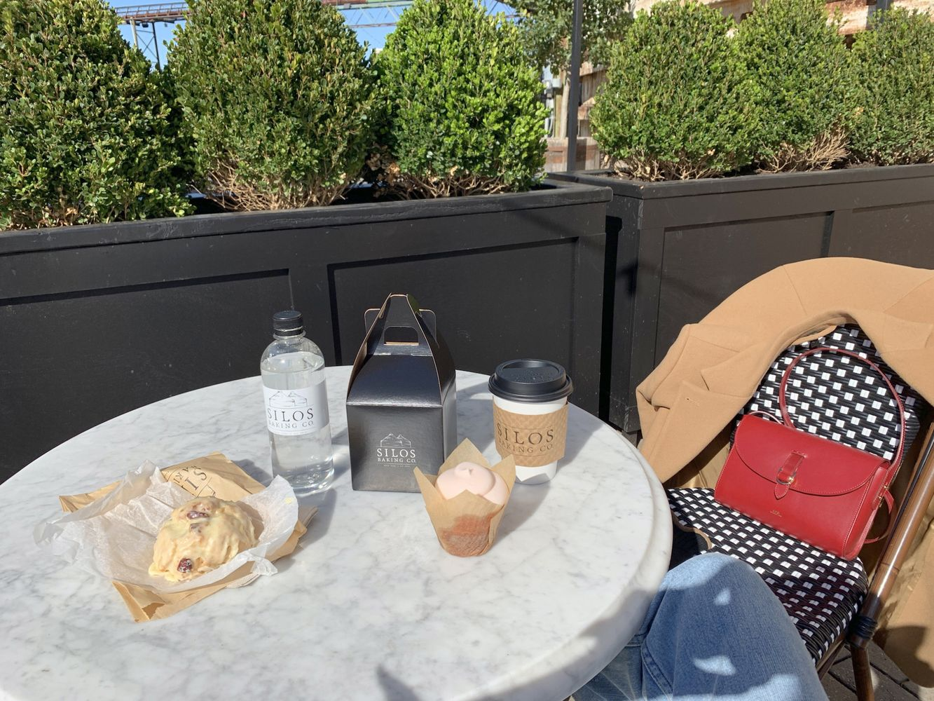 Strawberry Cupcake, Orange Scone and Coffee on the Marble Tables outside Magnolia Bakery
