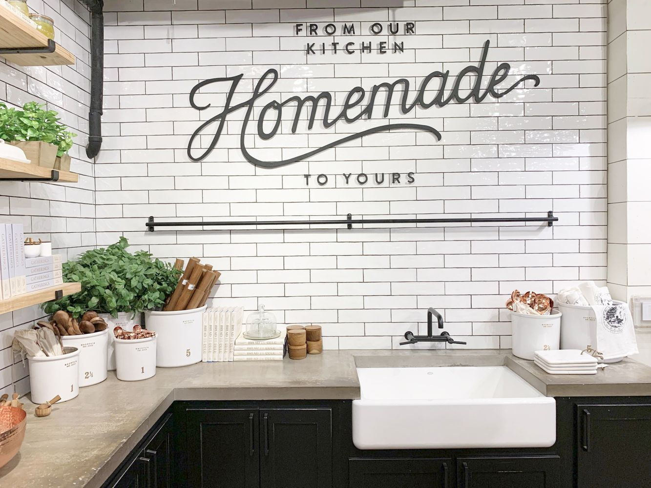 Subway Tile and Concrete Countertop Kitchen Display at Magnolia Market